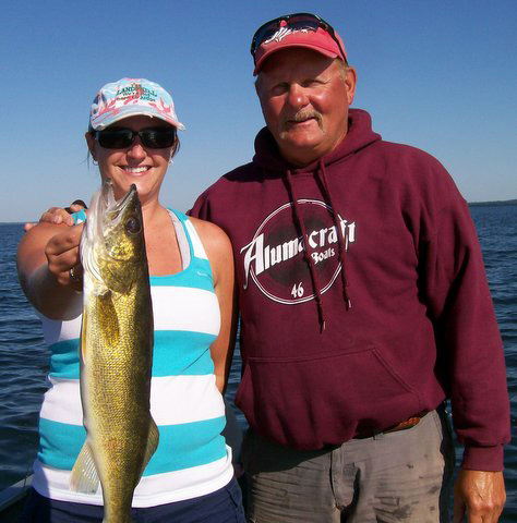 Fishing guide Charlie Worrath with happy customer