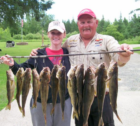 Fishing guide Charlie Worrath with happy clients
