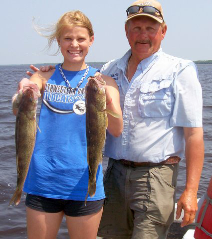 Charlie Worrath clients with walleye catch on Lake Winnie