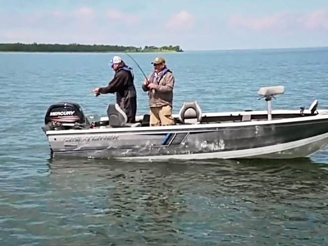 Jason Mitchell Outdoors host Jason Mitchell with MN Fishing Pro Guide Charlie Worrath and early season walleye