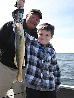 Charlie Worrath of Charlie's Gone Fishing Guide Service with happy guide clients