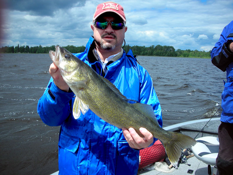 MN Fishing Pro Guide Jason Boser with walleye fishermen, 2014