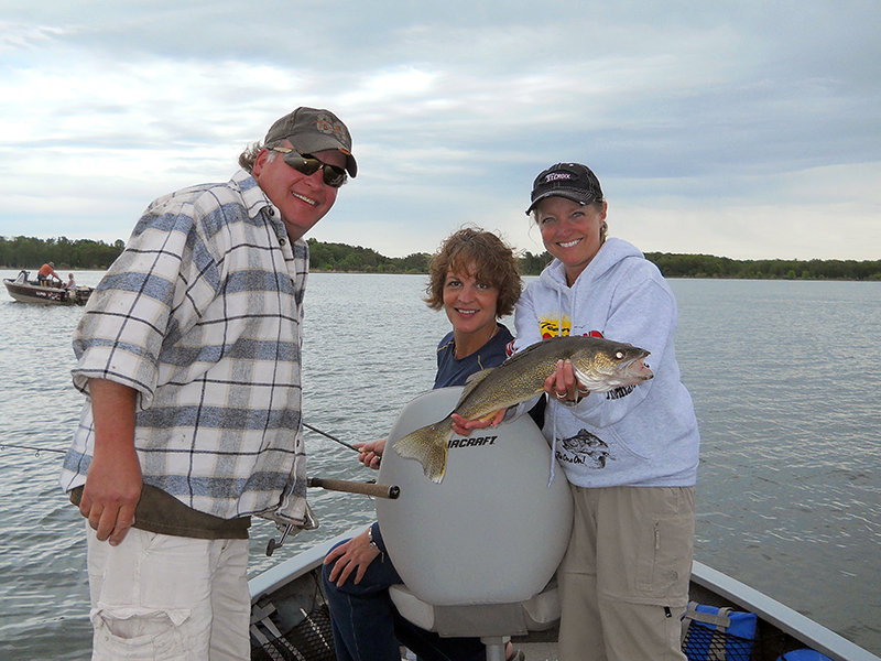 MN Fishing Pro Guide Jason Boser's fishing clients with walleye, 2013