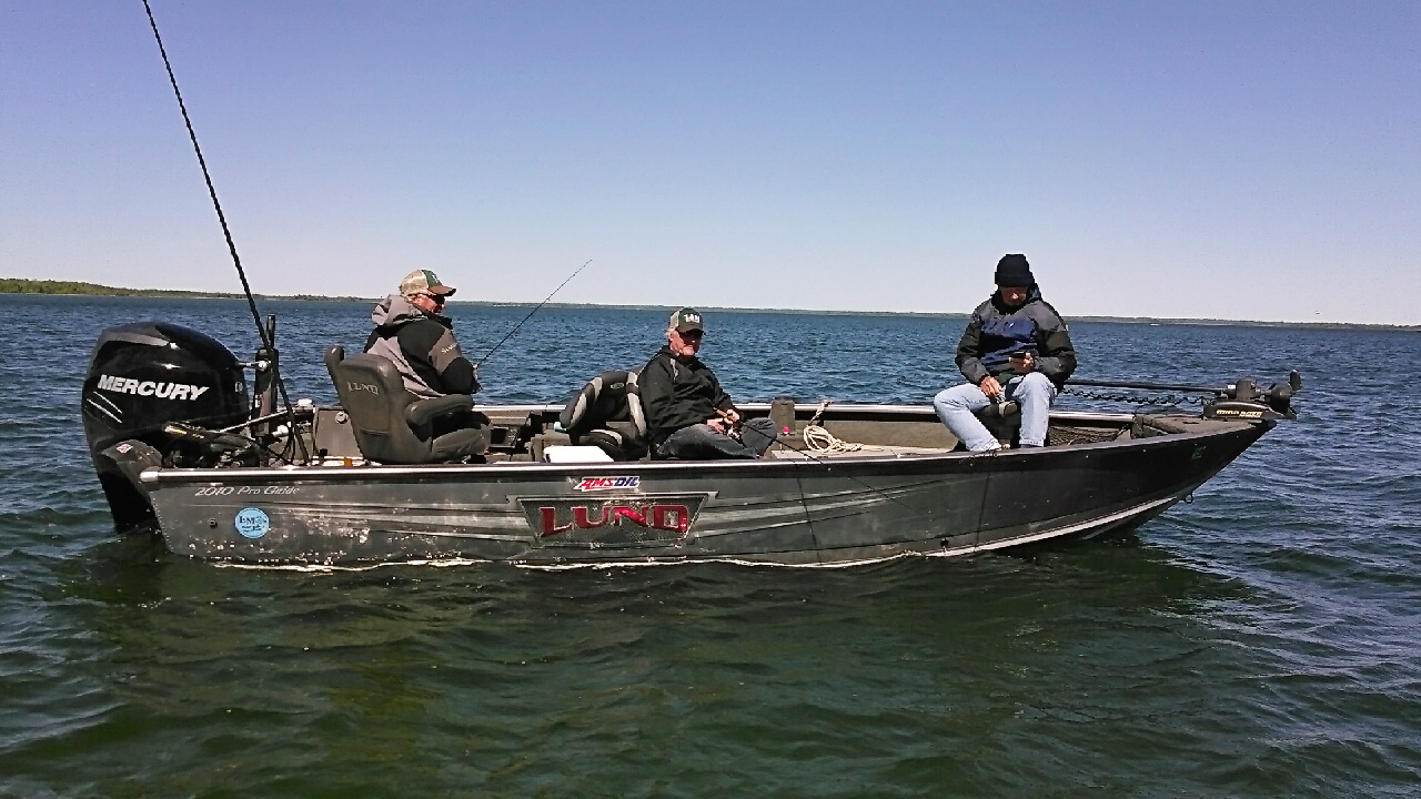 Jeff 'Cubby' Skelly on fishing Ball CLub Lake with clients in Lund fishing boat, 2017