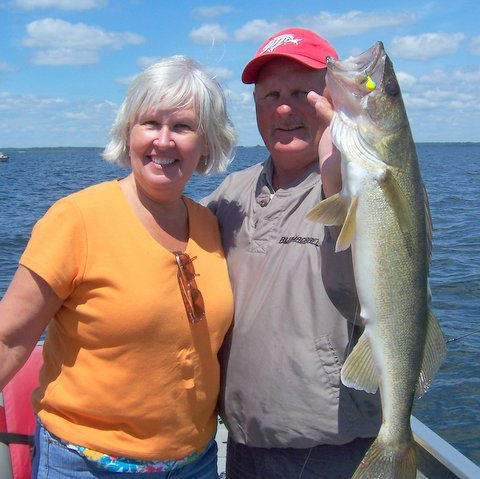 Professional Northern Minnesota fishing guide Charlie Worrath with walleye
